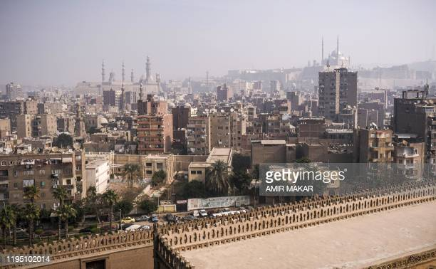 This picture taken on January 11 2020 from the minaret of the ninth century mosque of Ibn Tulun shows a view of the mosque's roof and a backdrop of...