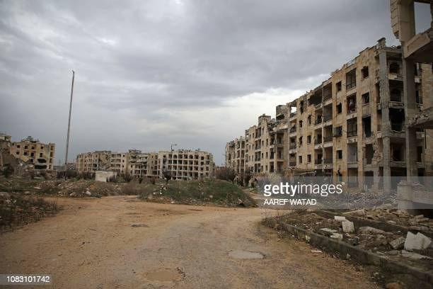 This picture taken on January 15 2019 shows a view of damaged buildings in alZahra neighbourhood on the northwestern outskirts of the northern city...