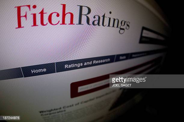 This picture taken on January 17 2012 in Paris shows a closeup of a page of the Ratings agency Fitch website AFP PHOTO / JOEL SAGET