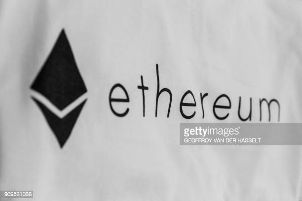This picture taken on January 17 2018 at La Maison du Bitcoin in Paris shows the Ethereum logo / AFP PHOTO / GEOFFROY VAN DER HASSELT