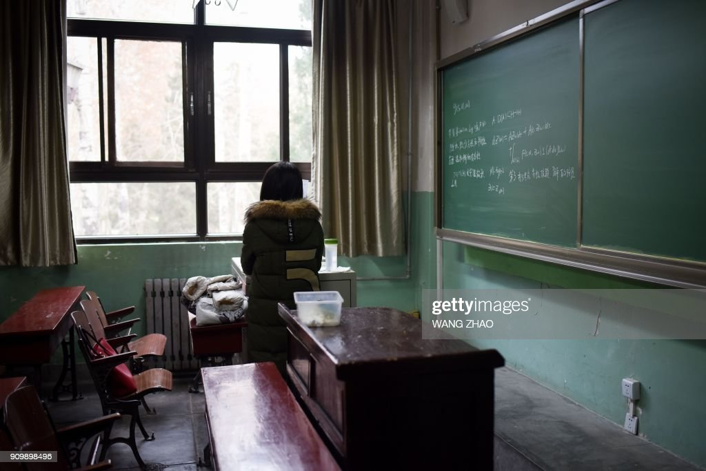 TOPSHOT - This picture taken on January 17, 2018 shows a female student in a classroom at Beihang University in Beijing. Beijing's Beihang University recently stripped a professor of his position as vice-director of the graduate school after an investigation established he had sexually harassed multiple students. The hashtags 'Me too' and 'Me too in China' quickly became trending topics on Weibo, with many more people speaking about their assaults in the forums. / AFP PHOTO / WANG ZHAO / TO GO WITH China-education-harassment-assault,FOCUS by Joanna CHIU