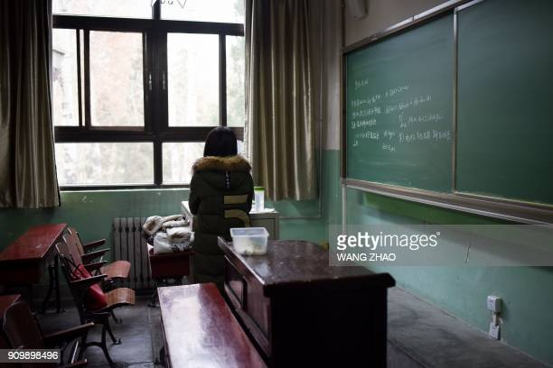 TOPSHOT This picture taken on January 17 2018 shows a female student in a classroom at Beihang University in Beijing Beijing's Beihang University...
