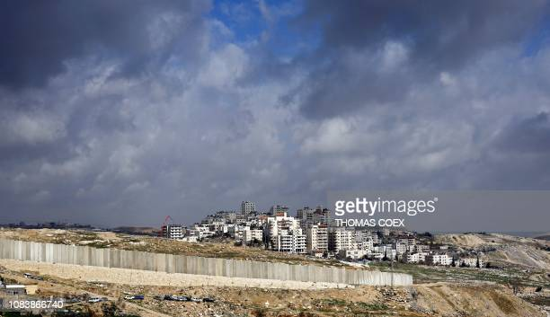 This picture taken on January 17 2019 from the Palestinian West Bank village of Eizariya shows the controversial Israeli separation barrier...