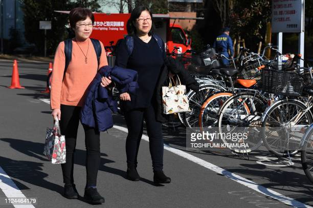 This picture taken on January 17 2019 shows same sex couple Yoko Ogawa and Chizuka Oe walking from a town hall after attempting to submit their...