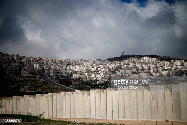 This picture taken on January 17, 2019 shows the controversial Israeli separation barrier separating the Palestinian West Bank village of Eizariya ,...