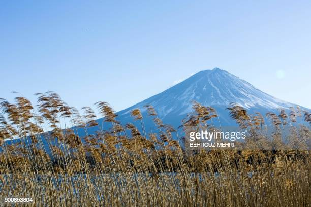 This picture taken on January 2 2018 shows Mount Fuji from Lake Kawaguchi in the town of Fujikawaguchiko Yamanashi prefecture