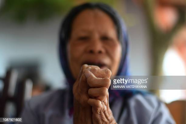 This picture taken on January 20 2019 shows a leprosy survivor offering prayers on the 15th day of lunar month at a pagoda in Van Mon Leprosy hospice...