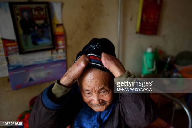 TOPSHOT This picture taken on January 20 2019 shows leprosy patient Nguyen Quang Chieu wearing his wool cap at the Van Mon Leprosy hospice compound...
