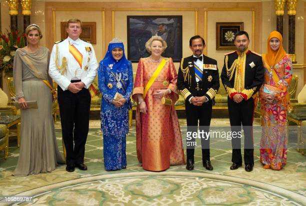 This picture taken on January 21 2013 shows Brunei Sultan Hassanal Bolkiah his spouse and Prince Haji AlMuhtadee Billah posing for pictures with...