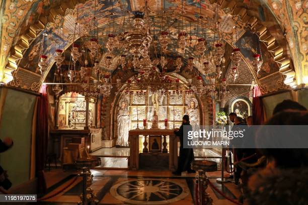 This picture taken on January 21, 2021 shows a an Orthodox Christian religious ceremony at the site of Calvary , traditionally regarded as the site...