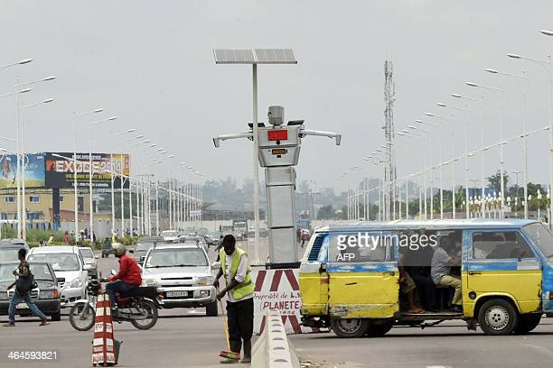 This picture taken on January 22 2014 shows a traffic robot cop on Triomphal boulevard of Kinshasa at the crossing of Asosa Huileries and Patrice...