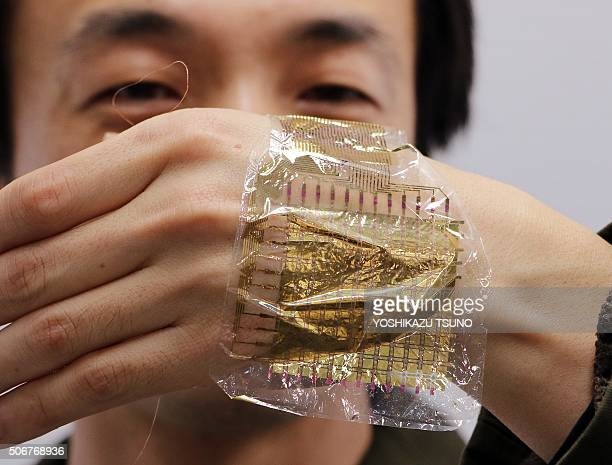 This picture taken on January 22, 2016 shows South Korean researcher Lee Sung-Won of Tokyo University's graduate school of engineering displaying a...