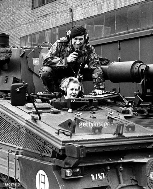 This picture taken on January 23 1976 shows Margaret Thatcher then chairwoman of the British Conservative Party and lieutnant Parradine sitting on a...