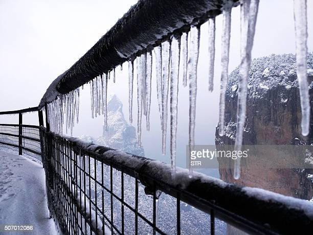 This picture taken on January 23 2016 shows the icecovered handrail on Shenxianju Mountain near the city of Taizhou in eastern China's Zhejiang...