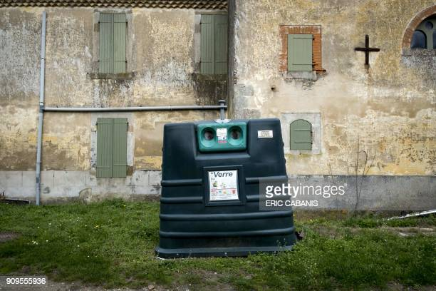 This picture taken on January 23 2018 shows a recycling bin on the side of a road in MontesquieuLauragais / AFP PHOTO / ERIC CABANIS