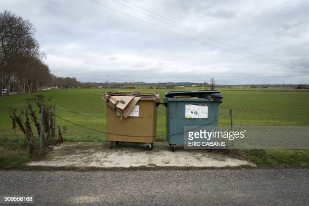 This picture taken on January 23 2018 shows recycling bins on the side of a road in MontesquieuLauragais / AFP PHOTO / ERIC CABANIS