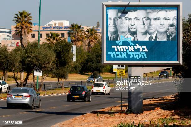 This picture taken on January 23 2019 in the Israeli coastal city of Tel Aviv shows a billboard showing the portraits of Israeli centrist leaders...