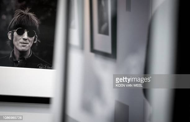 This picture taken on January 23, 2019 shows a photography of Beatles member George Harrison by Robert Whitaker from a private collection of...