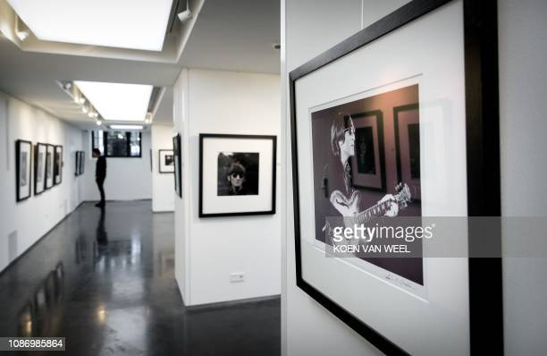 This picture taken on January 23, 2019 shows photographies of Beatles members realised by Robert Whitaker from a private collection of exclusive...