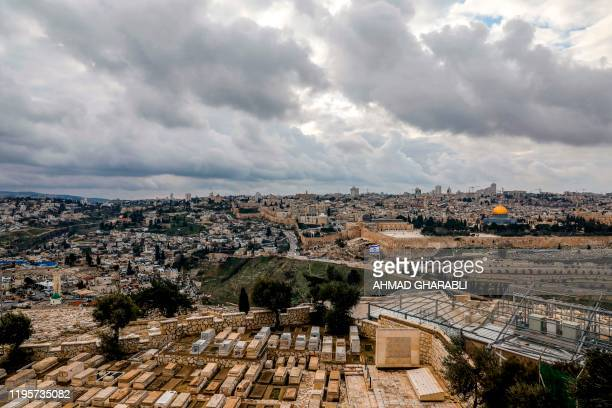 This picture taken on January 24 2020 from the Mount of the Olives shows a view of the Jewish cemetery below the Dome of the Rock and alAqsa mosque...