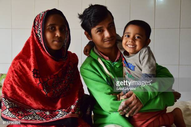 This picture taken on January 25 2018 shows Tree Man Abul Bajandar and his family poses for a photo at Dhaka Medical College Hospital in Dhaka...