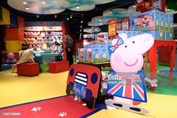 This picture taken on January 25 2019 shows a billboard of Peppa Pig displayed at a toy store in Beijing Roasted as a subversive symbol and chopped...