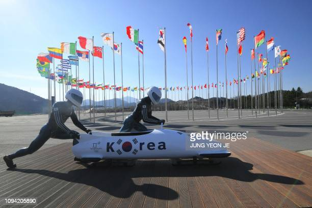 This picture taken on January 25 2019 shows a dummy South Korean bobsleigh team at a photo zone at the Olympic Plaza in Pyeongchang Just one year...