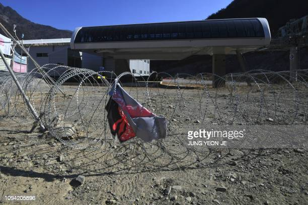 This picture taken on January 25 2019 shows a gondola lift terminal with barbedwire entanglements around at the Jeongseon Alpine Centre where...