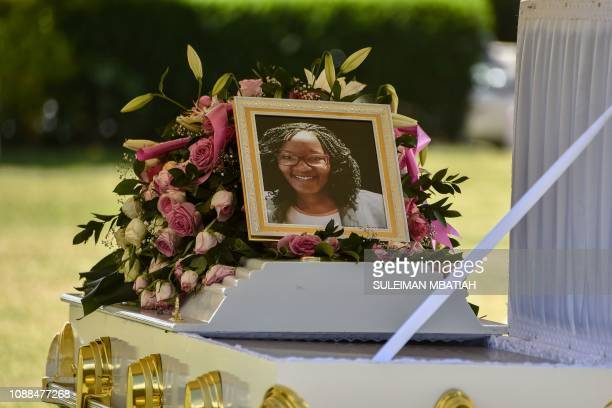 This picture taken on January 25, 2019 shows a portrait of Trufosa Nyaboke on the coffin during her burial ceremony in Nakuru, Kenya as she was among...