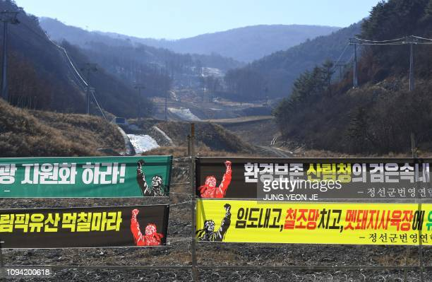 This picture taken on January 25 2019 shows protest banners demanding the site's development at the Jeongseon Alpine Centre where downhill skiing...