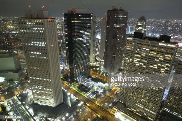 This picture taken on January 25 2020 shows a general view of skyscrapers in Tokyo's Shinjuku area Tokyo's benchmark Nikkei index dropped more than...
