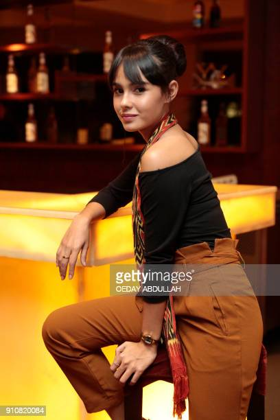 This picture taken on January 26 2018 shows Indonesian news anchor Angie Ang posing during a promotional event in Jakarta / AFP PHOTO / OEDAY ABDULLAH