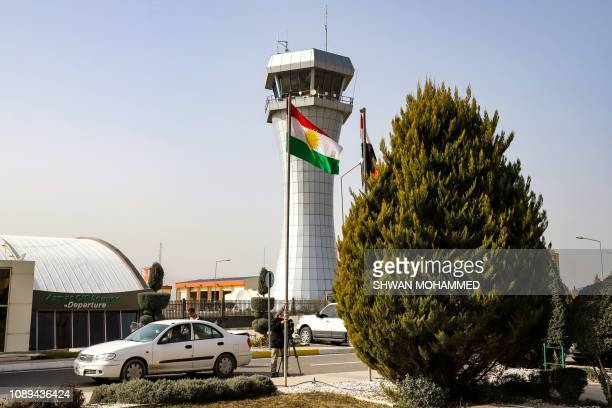 This picture taken on January 26 2019 shows journalists filming outside the departure lounge and control tower of Sulaymaniyah International Airport...