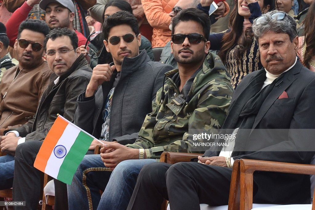 This picture taken on January 26 shows Indian actors Sidharth Malhotra Manoj Bajpayee Mohammed Zeeshan Ayyub former Indian cricketer Kapil Dev and...