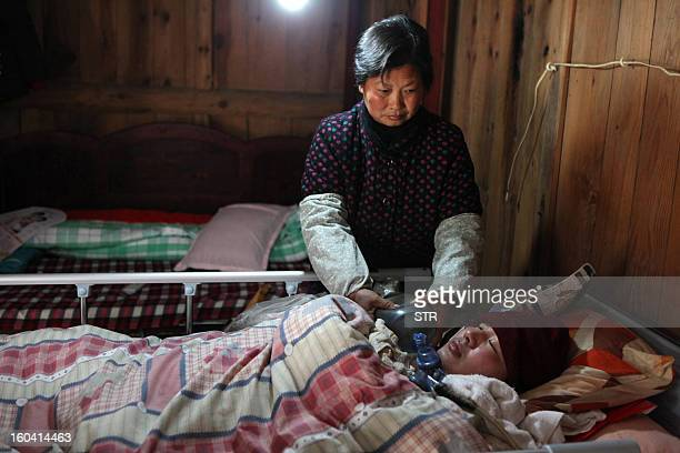 This picture taken on January 28 2013 shows a selfmade ventilator that Fu Xuepeng a former mechanic who was paralyzed in a road accident when he was...