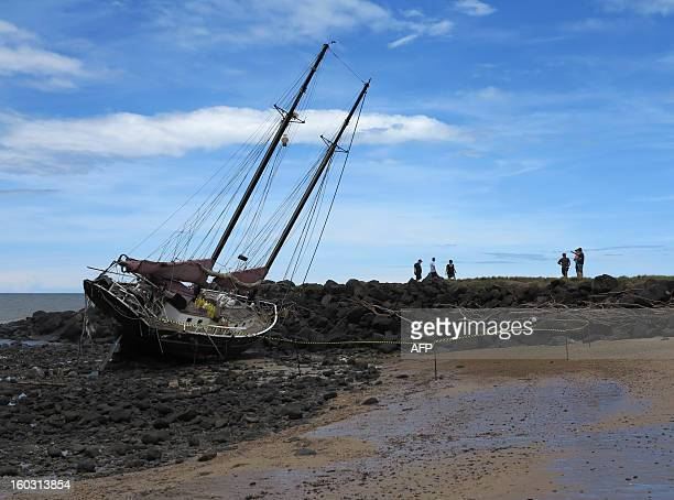 This picture taken on January 28 2013 shows the twin masted yacht the 'Patricia Mary' washed up on Baraga Beach in Bundaberg after the passing of...