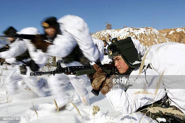 This picture taken on January 28 2015 shows Chinese soldiers attending a winter training session in freezing temperatures in Heihe northeast China's...
