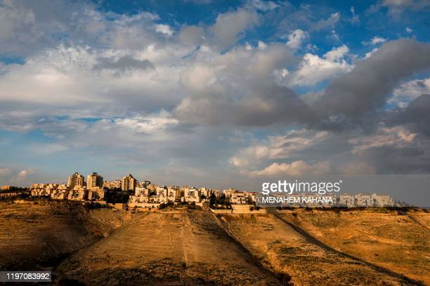 TOPSHOT This picture taken on January 28 2020 from the town of Eizariya in the occupied West Bank shows a view of the settlement of Maale Adumim...