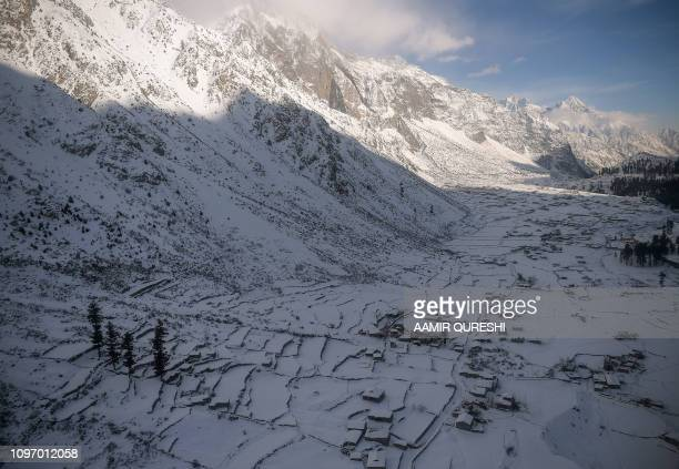 This picture taken on January 28 shows a general view of the snowcovered homes in the Naltar Valley where the CAS Karakoram International Alpine Ski...