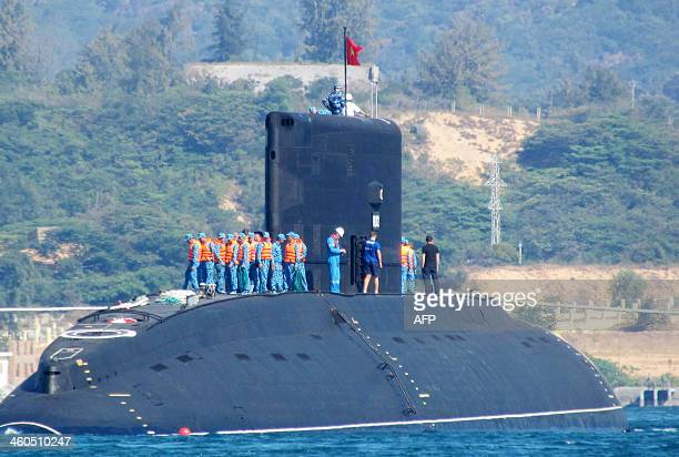 This picture taken on January 3 2014 shows the Vietnamese Navy's first submarine class Kilo 636 named 'Hanoi' being released into the sea from a...