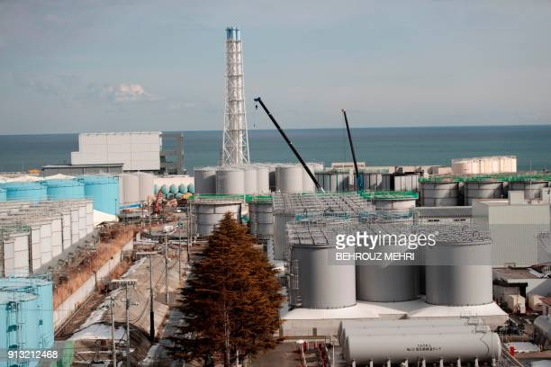 This picture taken on January 31 2018 shows the reactor number 4 building and storage tanks for contaminated water at the Tokyo Electric Power...