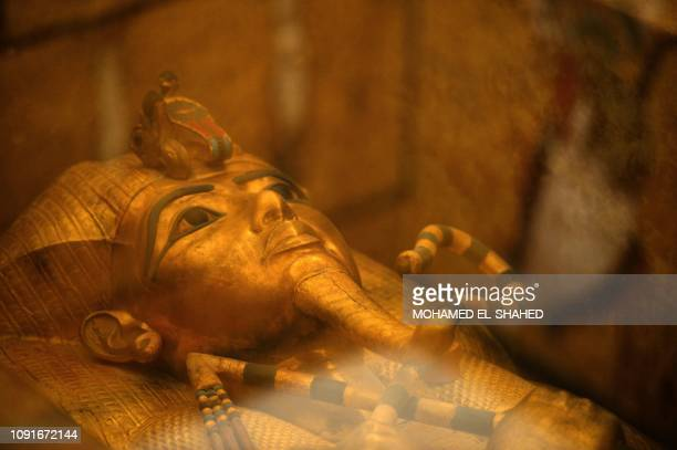 This picture taken on January 31 2019 shows the head of the golden sarcophagus of the 18th dynasty Pharaoh Tutankhamun displayed in his burial...