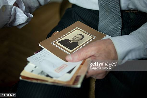 CZARNECKA This picture taken on January 5 2015 shows Jozef Paczynski 95yearold survivor of the Auschwitz nazi concentration camp showing a photo of...