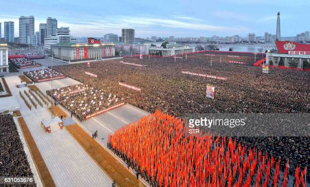 TOPSHOT This picture taken on January 5 2017 and released by North Korea's official Korean Central News Agency on January 6 2017 shows a mass rally...