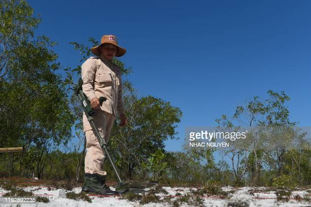 This picture taken on January 6 2020 shows a member of an allfemale demining team exploring for unexploded ordnance at a landmine site in the Trieu...