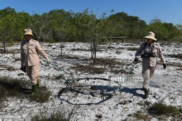 TOPSHOT This picture taken on January 6 2020 shows members of an allfemale demining team exploring for unexploded ordnance at a landmine site in the...