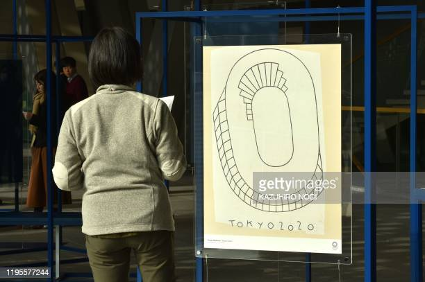This picture taken on January 7 2020 shows one of official Olympic and Paralympic posters titled Olympic Stadium by Philippe Weisbecker on display at...