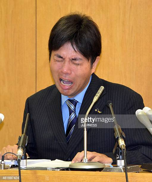 This picture taken on July 1 2014 shows 47yearold provincial politician Ryutaro Nonomura crying at a press conference to explain his profligate use...