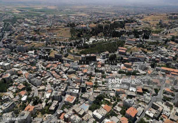 This picture taken on July 1, 2021 during a press tour provided by the Lebanese Air Force shows an aerial view of the city of Zahle in Lebanon's...