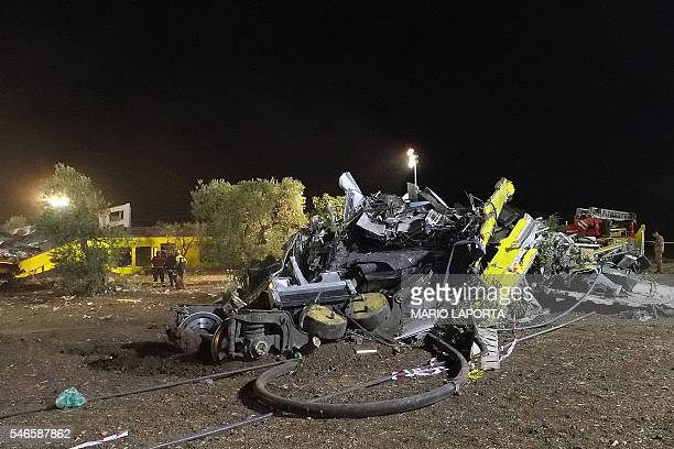 This picture taken on July 12 2016 shows the wreckage of a train after a headon collision between two trains near Corato in the southern Italian...